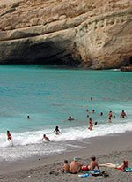 tourists at matala beach in crete